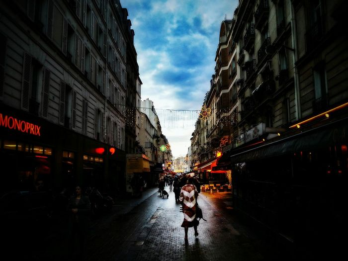 Walk to the light. Architecture Paris France Streetphotography Street Photography City Citylife Street City Street Building Exterior Built Structure City City Life Car Sky Outdoors People Day An Eye For Travel Mobility In Mega Cities Stories From The City