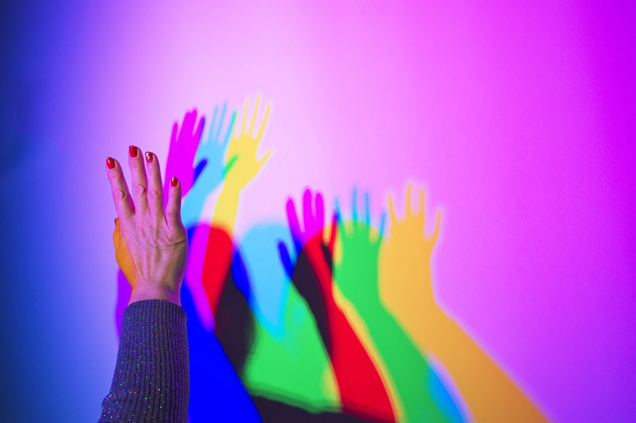 Close-Up Of Multi Colored Shadows On A Wall