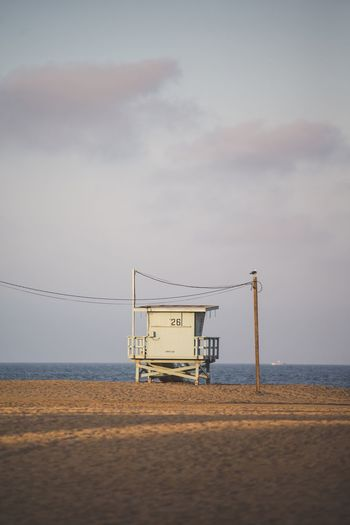 Sea Beach Sand Water Scenics Horizon Over Water Nature Beauty In Nature Tranquil Scene Lifeguard Hut Sky Tranquility Shore Lifeguard  Outdoors Cloud - Sky No People Day Built Structure Beach Volleyball