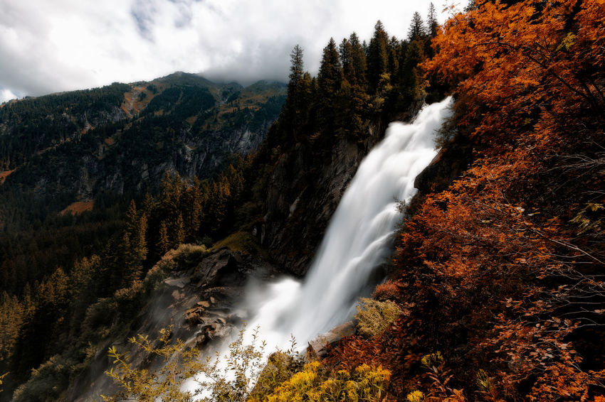 Krimml Waterfalls , Austria. Krimml Waterfalls , Austria. Autumn Beauty In Nature Blurred Motion Change Cloud - Sky Day Environment Flowing Flowing Water Krimml Waterfalls Krimmler Krimmler Wasserfalle Krimmlerwasserfälle Land Long Exposure Motion Mountain Mountain Peak Nature No People Non-urban Scene Outdoors Plant Power In Nature Scenics - Nature Sky Tree Water Waterfall Waterfalls