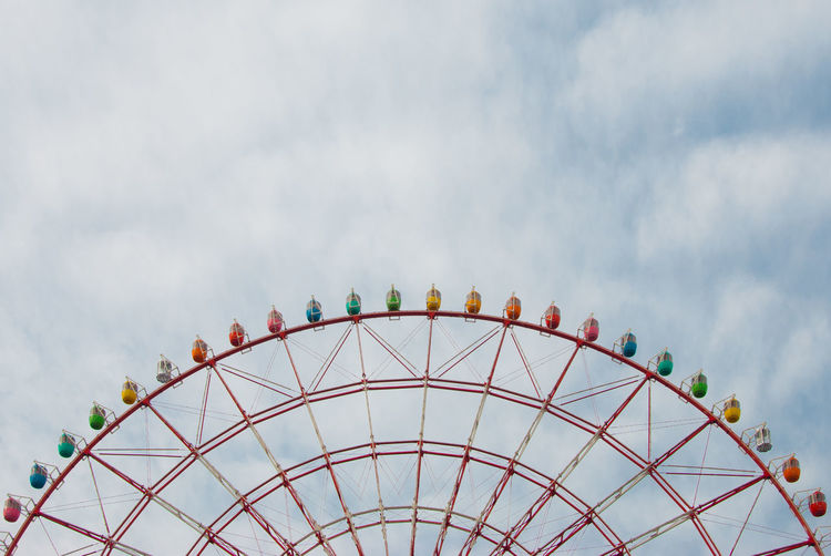 Ferris wheel in an amusement park in Tokyo, Japan. Amusement Park Amusement Park Ride Cloud - Sky Cloudy Colorful Colors Ferris Wheel High Section Low Angle View Multi Colored No People Overcast Sky Tokyo