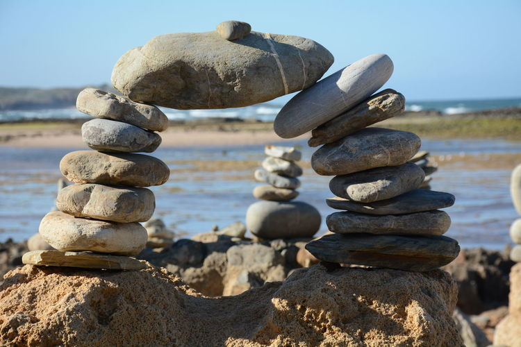 Stack Balance Solid Rock Sky Stone - Object Land Nature Zen-like Beach Tranquility Focus On Foreground Rock - Object Day Water No People Sunlight Sea Tranquil Scene Close-up Outdoors Pebble Rock Tower Stone Tower Portugal Vila Nova De Milfontes Europe Travelphotography Idyllic Scenery Ocean Sunny