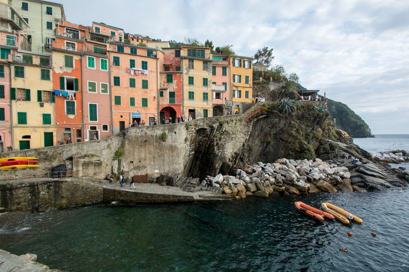Riomaggiore village one of the five town of Cinque Terre in Liguria Italy Architecture Boats Building Exterior Built Structure Cinque Terre Liguria Cloud - Sky Day Fishing Italia Italy Nature Nautical Vessel No People Outdoors Riomaggiore Sea Sky Travel Destinations Vacations Water Waterfront