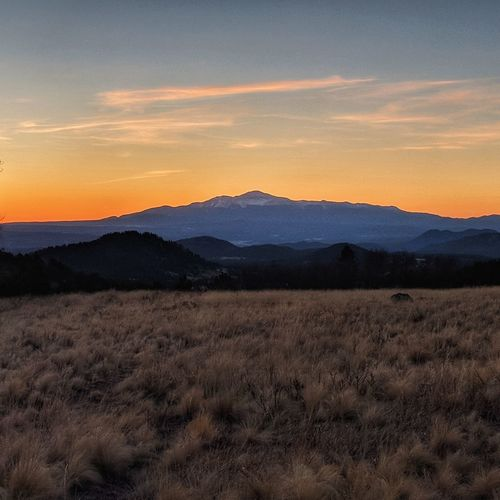 Pikes Peak facing East. Colorado Photography Coloradophotographer Colorado Life Alpine Glow Pikes Peak Wilkersonpass America's Mountain Alpine Glowing EyeEm Selects Astronomy Tree Mountain Sunset Rural Scene Moon Agriculture Dramatic Sky Sky Landscape Arid Landscape Atmospheric Mood
