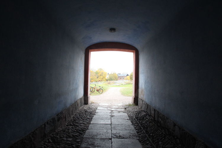 View of field seen through tunnel at suomenlinna