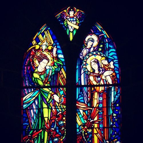 Church Leaded Window Colors red blue green yellow france normandie mont saint michel burning candle