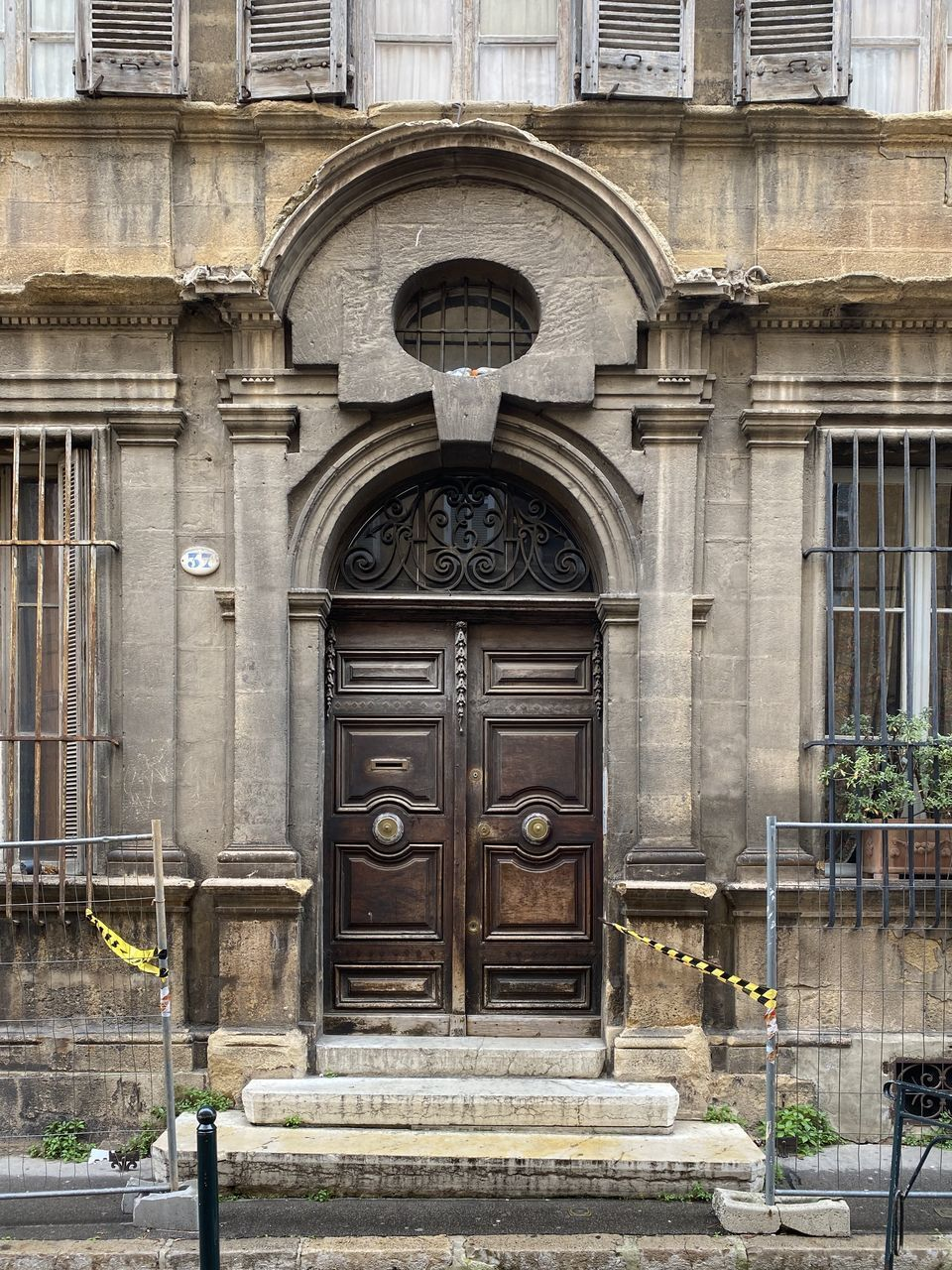 building exterior, architecture, built structure, entrance, door, closed, no people, day, building, history, the past, arch, security, city, protection, outdoors, old, safety, facade, residential district, ornate, carving