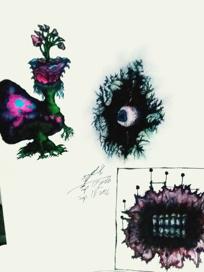 Indoors  Still Life Art And Craft Decoration Creativity Ideas Multi Colored Arrangement Mask - Disguise Decorated No People Creative Art Sharpie Art Art From Another View Drawing Pen And Ink Sketch Painted Image Symbol Green Color Growth Creativity Art And Craft Tree