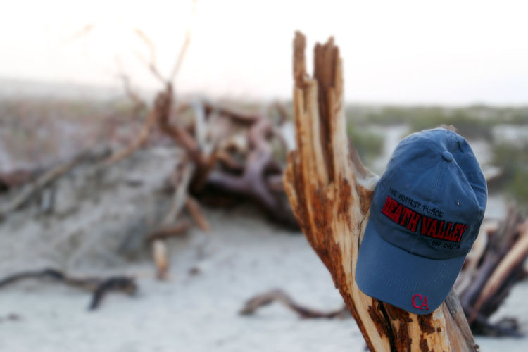 California Death Valley Death Valley National Park USA Baseball Cap Beach Close-up Communication Day Focus On Foreground Nature No People Outdoors Road Trip Sand Sky Text