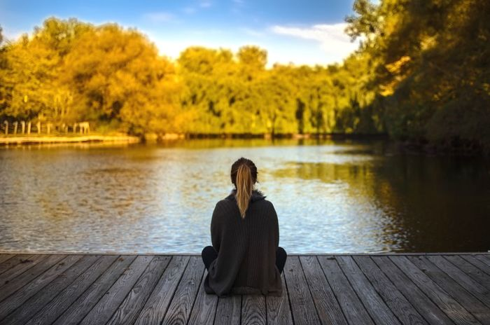 Water Tree Lake Sitting Tranquil Scene Nature Pier Yoga Jetty One Person Relaxation Beauty In Nature Lifestyles Tranquility Scenics Outdoors Full Length Real People Young Adult Women Second Acts Fresh on Market 2017 Perspectives On Nature