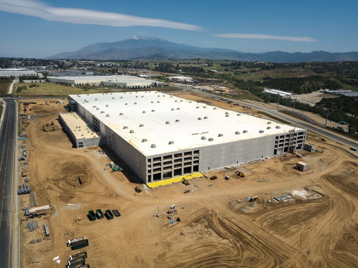 Beaumont, CA / USA - 4/20/2019: Overhead view of a new Amazon Fulfillment Center under construction. High Angle View Day Architecture Built Structure No People Outdoors Construction Construction Site Warehouse Distribution Logistics Equipment New Building  Amazon Overhead View Sky Environment Nature Mountain Building Exterior Landscape Industry Land Cloud - Sky Sunlight Scenics - Nature Fuel And Power Generation Transportation Travel Pollution