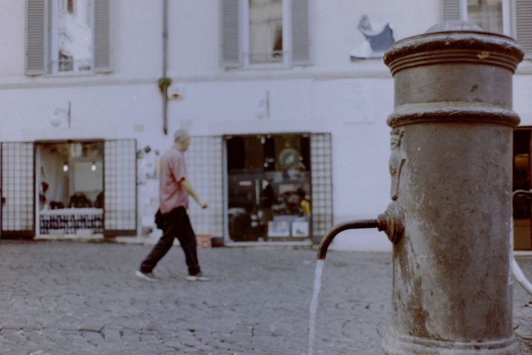 rione monti italian city Lomography nasone people and places Shop Rione Monti Italian City Lomography Nasone Street Photo Selective Focus Rome Italy Pavement Water Film Photography Public Places Outdoors Fountain_collection City Street Italian Urban Exploration Motion Full Length Building Exterior Drinking Fountain Fountain