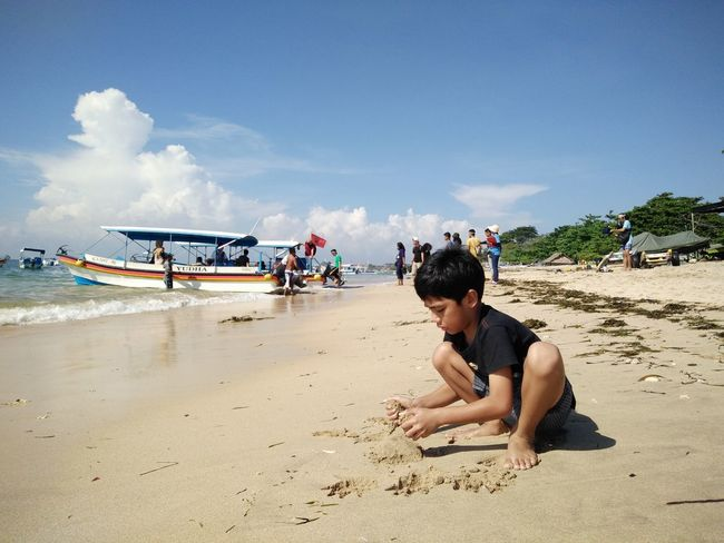 Beach Cloud Cloud - Sky Coastline Day Leisure Activity Lifestyles Mode Of Transport Nature Outdoors Sand Sea Shore Sky Summer Sunlight Sunny Tourism Tourist Tranquil Scene Tranquility Travel Destinations Vacations Tanjungbenoa Bali, Indonesia