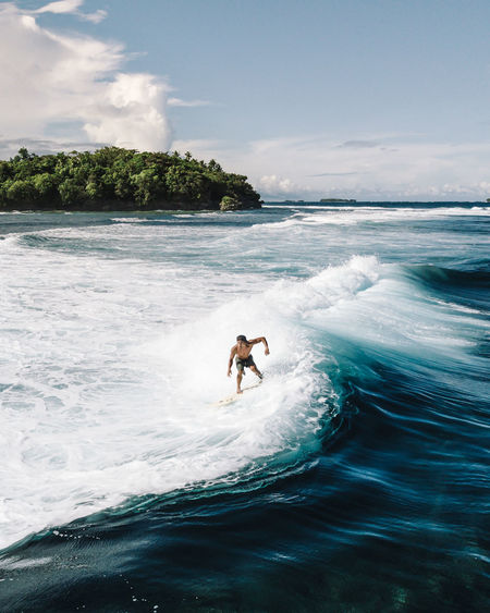 ride the tide 🏄🏾 #legend #surf #siargao #philippines #dji #mavicpro #vscox DJI Mavic Pro Philippines Surf Adventure Aerial Photography Day Dji Drone Photography Extreme Sports Fun Horizon Over Water Lifestyles Motion Nature One Person Outdoors Real People Sea Siargao Siargao Island Sports Surfing Water Water Sports Wave The Traveler - 2018 EyeEm Awards My Best Photo