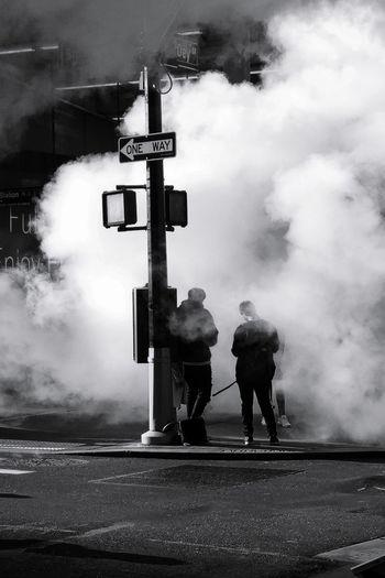 Men on road against sky