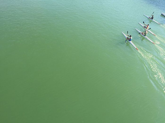 High angle view of people on kayak in sea