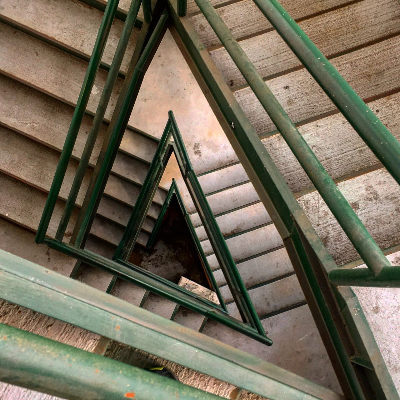 staircase, steps, steps and staircases, railing, architecture, stairs, built structure, high angle view, spiral, wood - material, hand rail, stairway, spiral staircase, no people, day, climbing, indoors