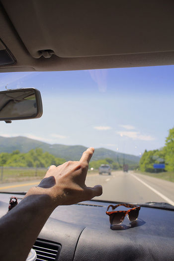 Adventure Car Dashboard Day Driving Human Finger Human Hand Men Mode Of Transport Mountain Mountain And Sky Mountains One Person Real People Road Trip Roadtrip Sky Sunglasses Transportation Travel Traveling Vehicle Interior