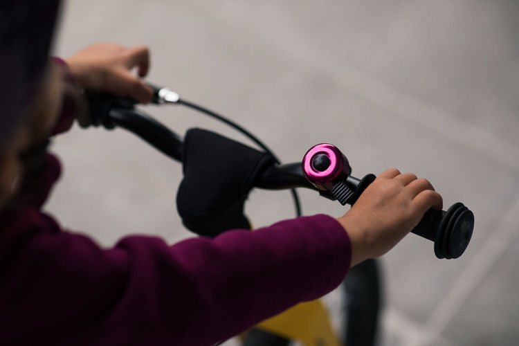 Close-up of woman hand holding pink camera