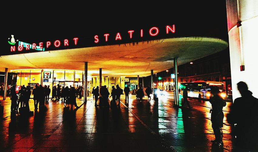 People in airport at night