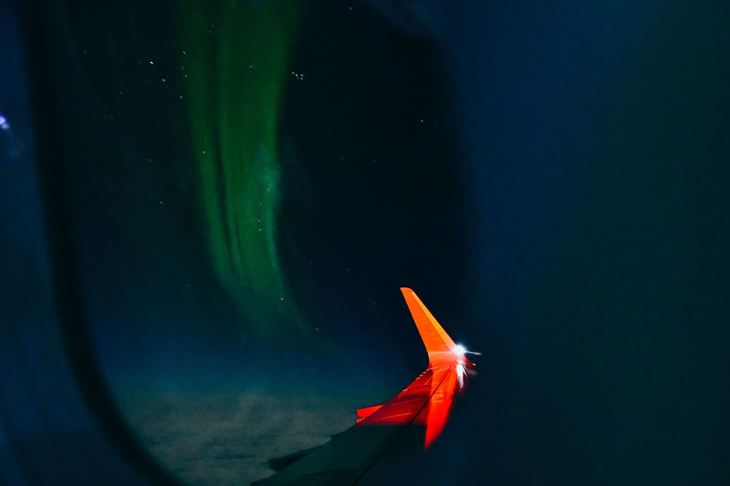 Northern lights seen through air plane window