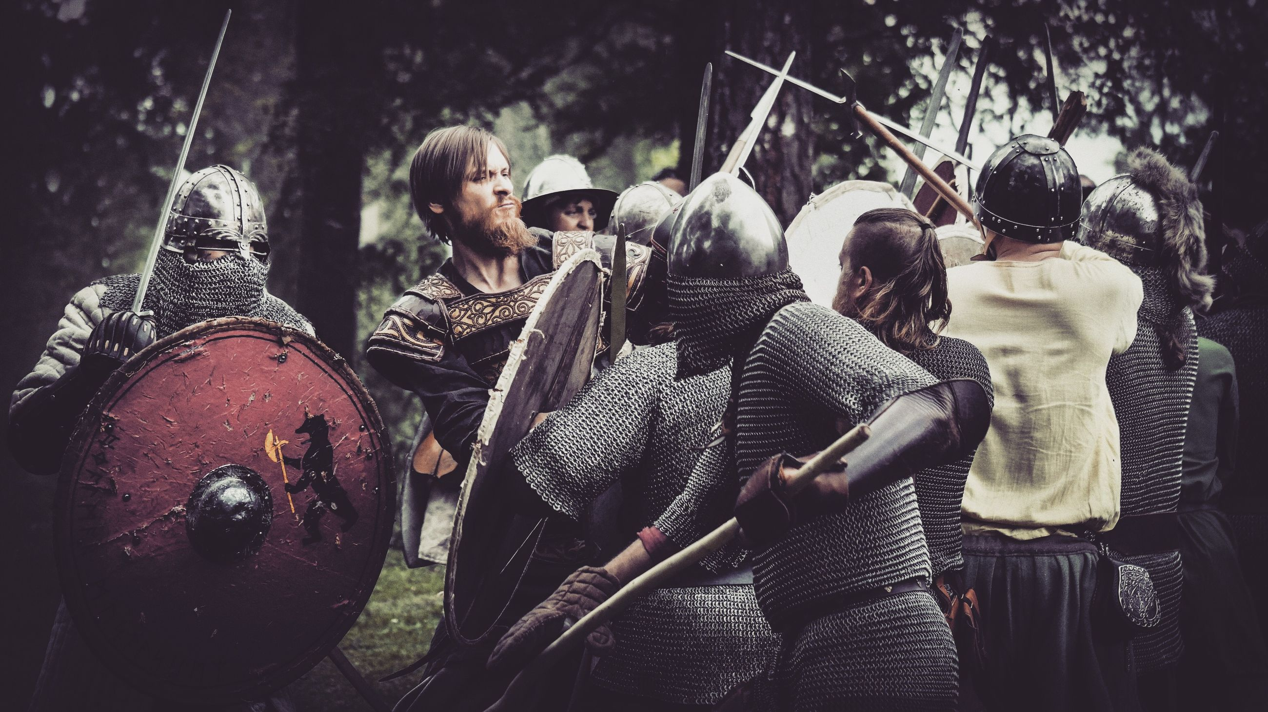rear view, real people, group of people, weapon, day, men, people, lifestyles, group, outdoors, clothing, tree, protection, nature, adult, knight - person, leisure activity, holding, history, the past, suit of armor