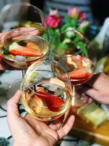 Glasses with strawberry wine Rose Wine Celebration Friends Wine Strawberry Human Hand Holding Real People One Person Human Body Part Food And Drink Unrecognizable Person Focus On Foreground Drink Refreshment Lifestyles Close-up Freshness Alcohol Day Indoors  Drinking Glass Women Wineglass