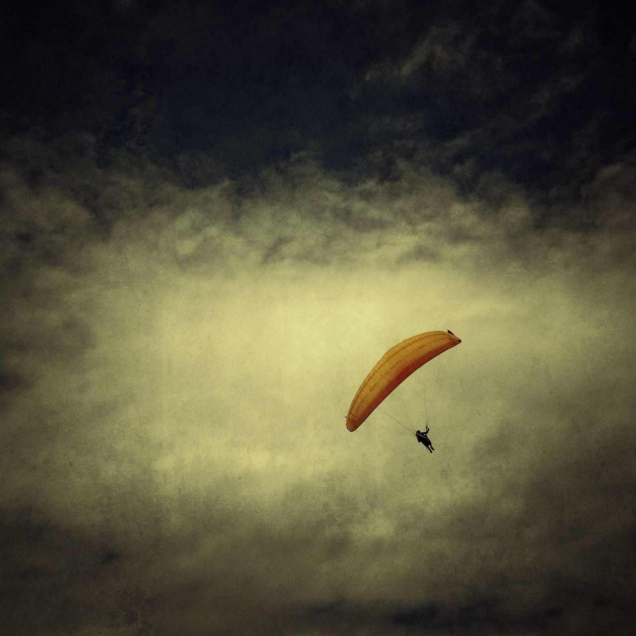 Low angle view of parachute against the sky