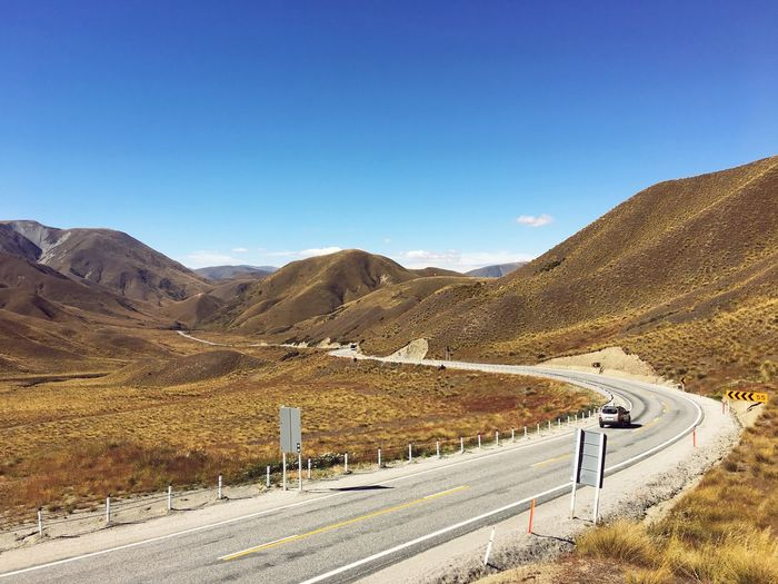 Mountain Road Scenics Blue Day The Way Forward Landscape Mountain Range Transportation Clear Sky Tranquility Beauty In Nature Nature Mountain Road Outdoors Highway Roadtrip New Zealand Lindis Pass Tranquil Scene Winding Road No People