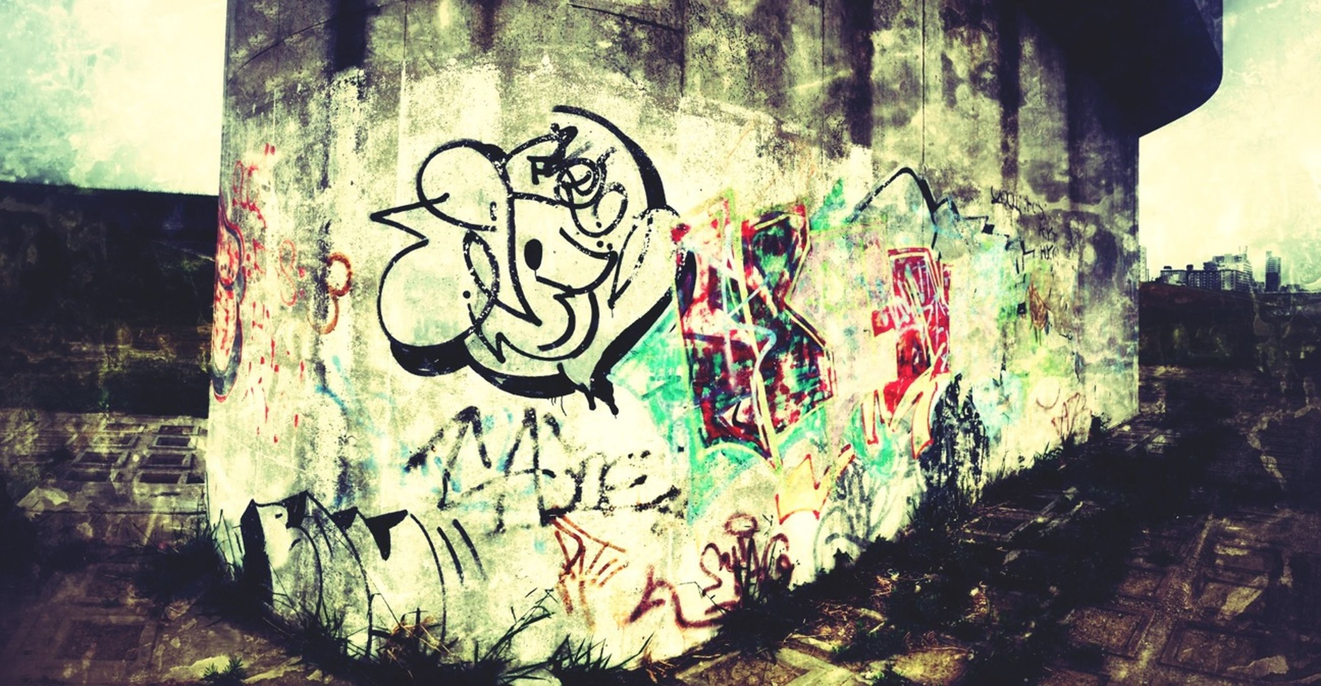 graffiti, art, creativity, art and craft, architecture, built structure, wall - building feature, building exterior, street art, multi colored, wall, text, human representation, mural, vandalism, design, painting, weathered, old, western script