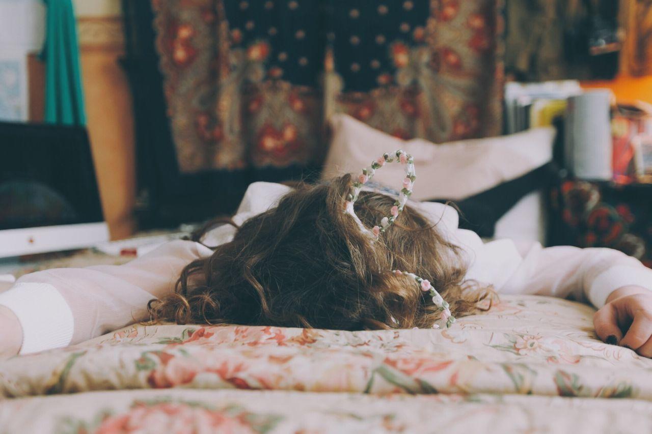 Tired girl sleeping in bedroom