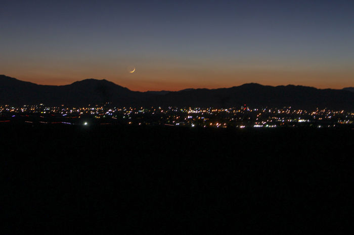 Moon over Pahrump, Nevada in Autumn 2018 Sky City Illuminated Built Structure Night Cityscape Mountain Nature Building No People Landscape Scenics - Nature Environment Silhouette High Angle View Outdoors Dark Pahrump Pahrump Nevada Moon