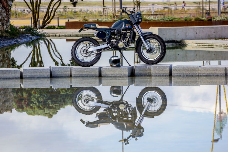 Redonda Motors Bicycle Day Land Vehicle Mode Of Transport Nature No People Outdoors Puddle Reflection Sky Stationary Tire Transportation Water Waterfront