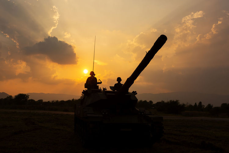 Tank with sunset Time Fight Armed Forces Armored Tank Army Army Soldier Cloud - Sky Field Government Guitar Land Land Vehicle Military Mode Of Transportation Nature No People Orange Color Outdoors Silhouette Sky Sunset Tank Transportation War Weapon