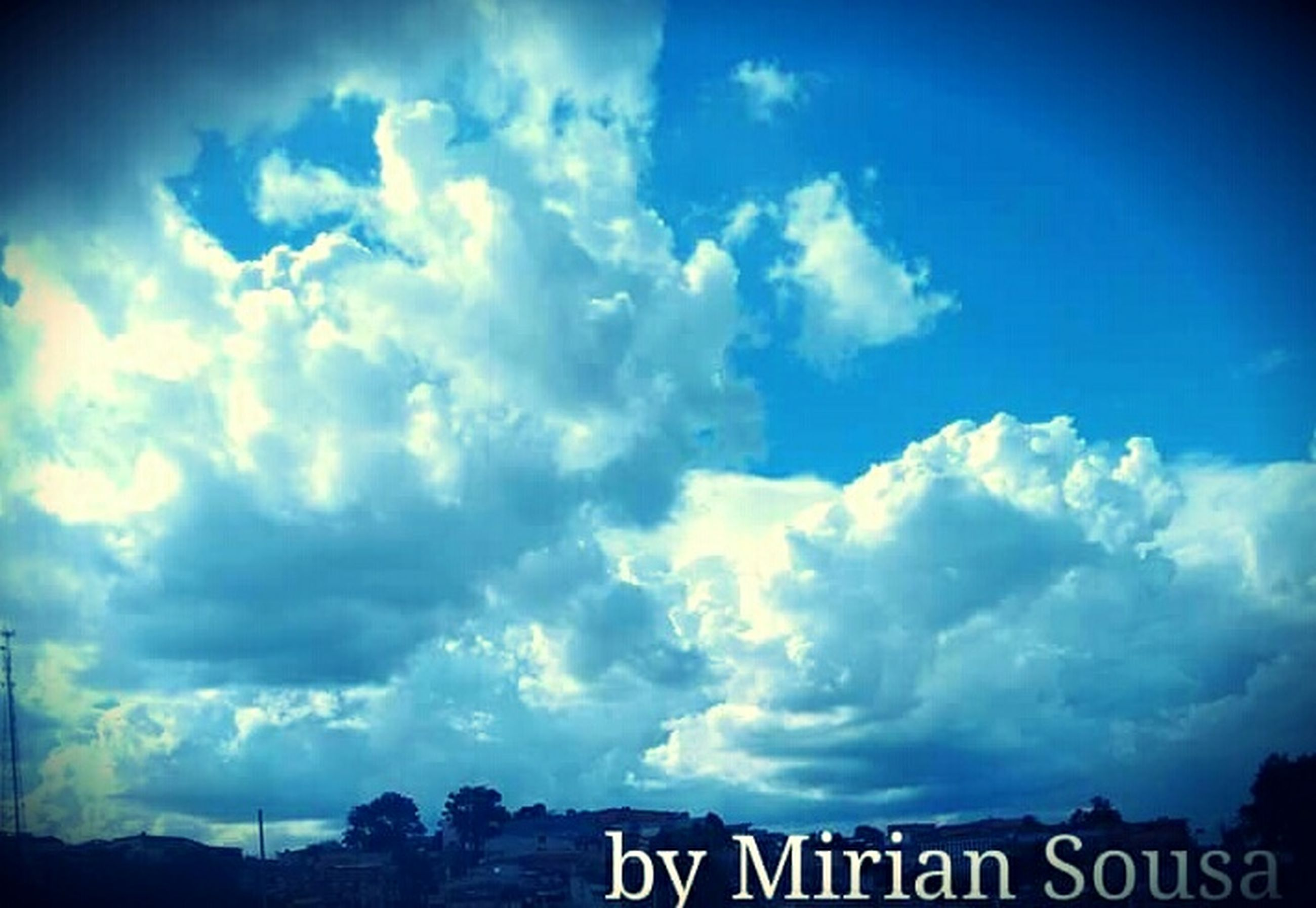 sky, cloud - sky, text, western script, communication, cloudy, cloud, low angle view, blue, tranquility, nature, scenics, sign, information sign, outdoors, tranquil scene, beauty in nature, no people, capital letter, day