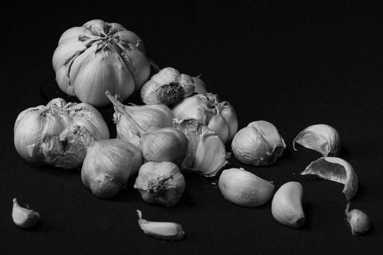 Close-up of vegetables on table against black background