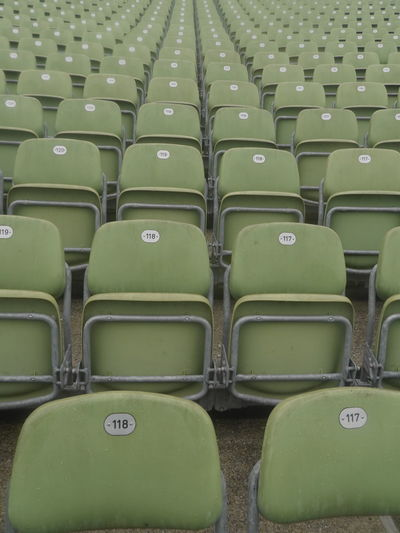 Full frame shot of empty folding chairs at stadium