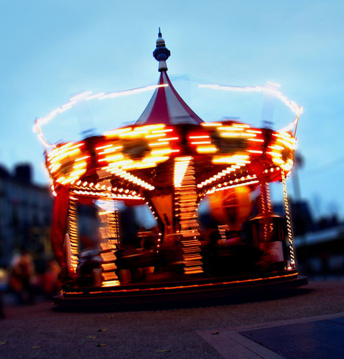 MERRY-GO-ROUND AT DUSK Amusement Park Ride Blue Blurred Motion Carousel Illuminated Merry-go-round Night Ligths Sky
