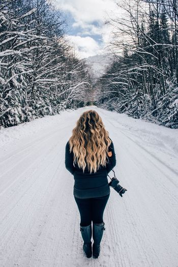 Woman on snow covered landscape