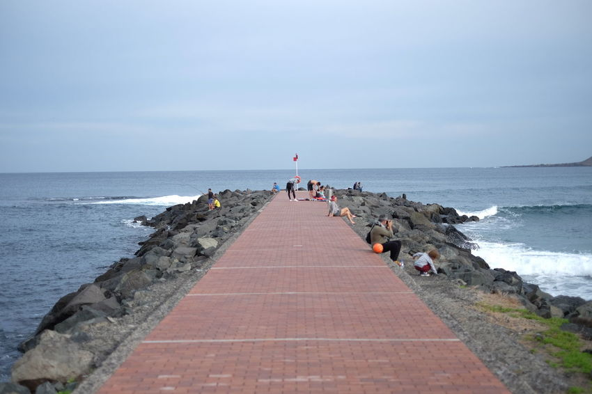 Composition Distant Footpath Horizon Over Water Incidental People Jetty Leading Ocean Outdoors Perspective Pier Rippled Sea Shore Stone The Way Forward Vacation Vacations Walkway Water Wood Wooden Post