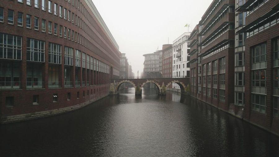 Hamburg City Center. · Germany 040 Hh Hamburgmeineperle Old Town Architecture City Urban Landscape Building Exterior Outdoors Water Channel Bridge Bridges Klinker Fog Gray Sky Gray Day