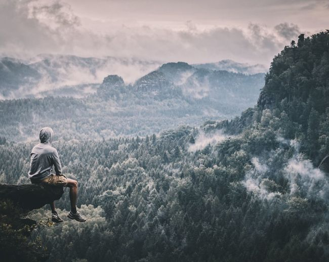 Sitting Mountain Real People Nature One Person Beauty In Nature Full Length Scenics Outdoors Day Sky Men Leisure Activity Lifestyles One Man Only People Perspectives On Nature
