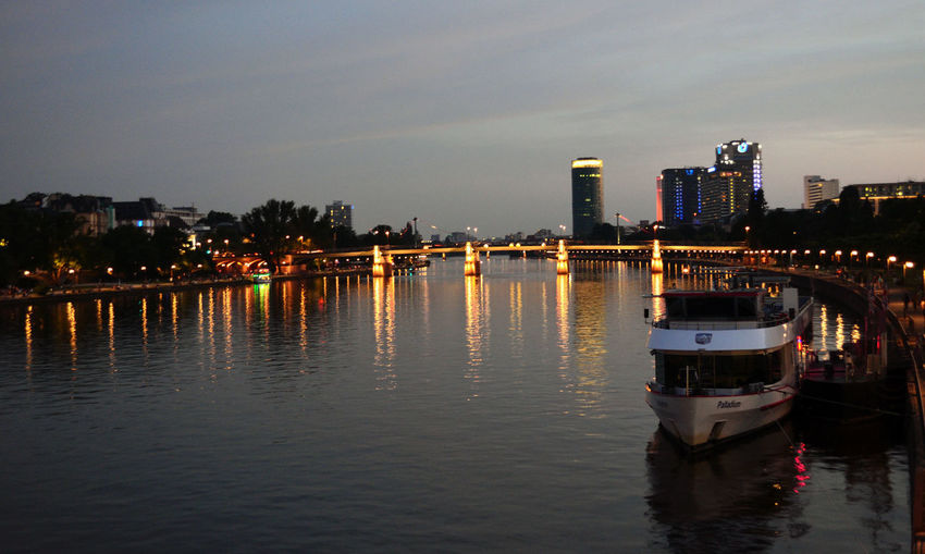 River with illuminated buildings in background