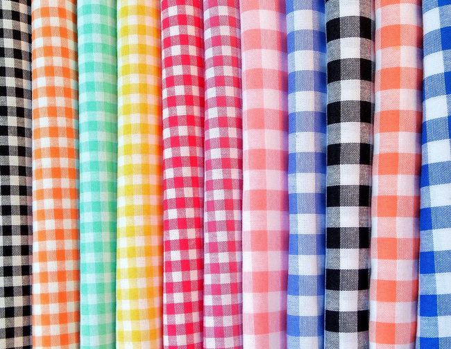 Full frame shot of multi colored checked pattern fabrics