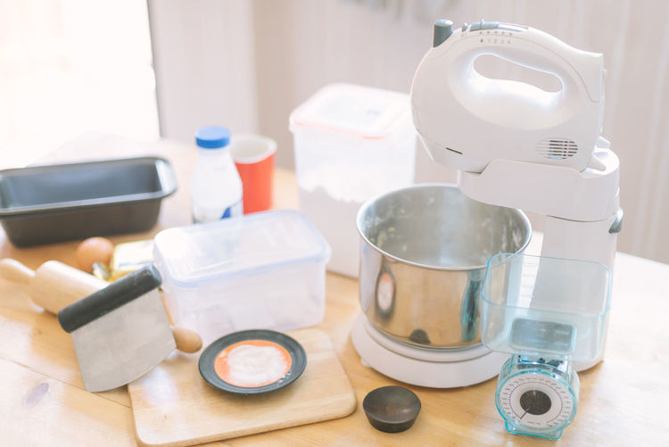 Homemade Bakery Container Cup Focus On Foreground High Angle View Homemade Bread Homemade Cake Household Equipment Indoors  Kitchen Scale Kitchen Utensil Mixer No People Rolling Pin Still Life Table Technology Wood - Material