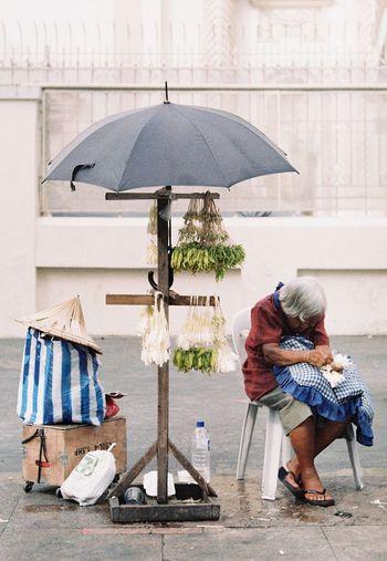 Full length of woman holding umbrella