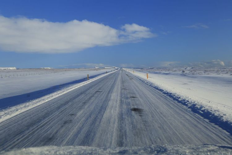 Road against sky during winter