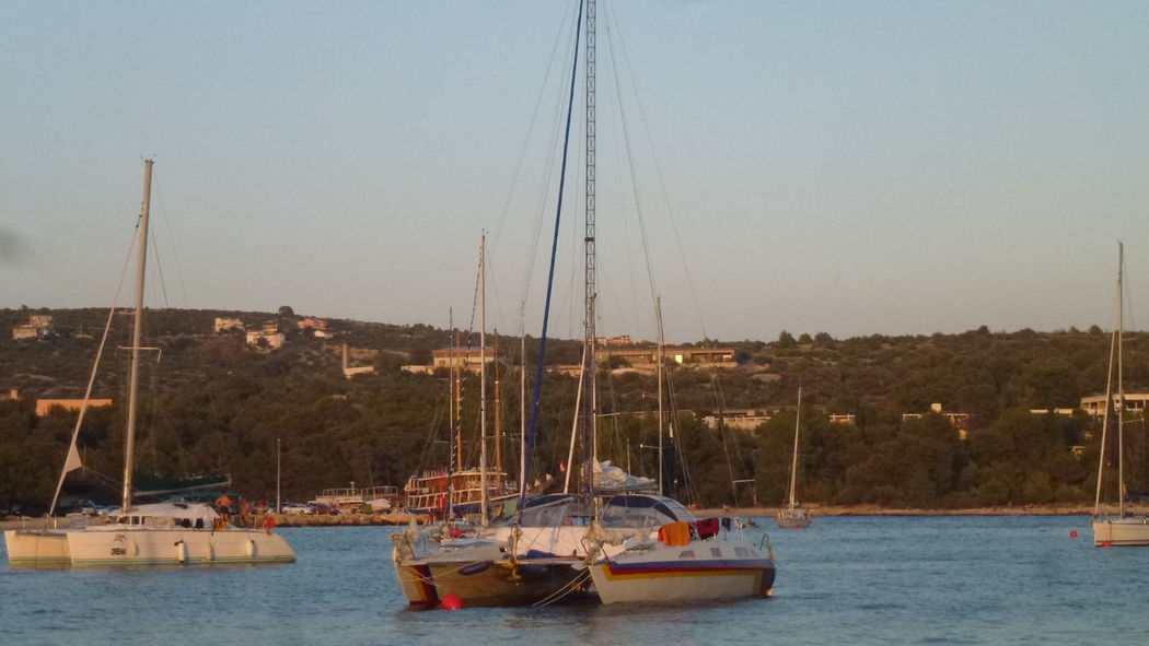 Beauty In Nature Boat Clear Sky Day Harbor Marine Mast Mode Of Transport Moored Mountain Nature Nautical Vessel No People Outdoors Sailboat Sailing Sailing Boat Scenics Sea Sky Transportation Water Waterfront Yacht