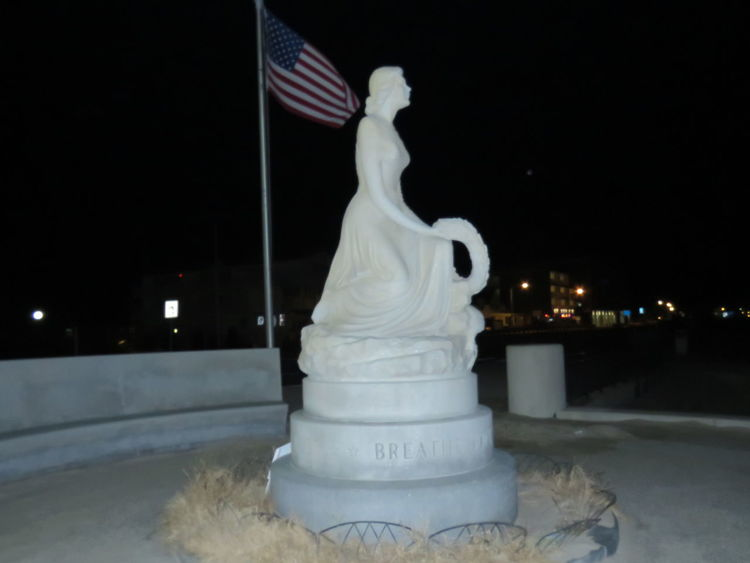 Hampton Beach Black Background No People City Lights By Night Flag Hampton Beach Men Lost At Sea Night No People Outdoors Patriotism Statue Of A Woman Colour Your Horizn