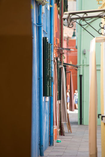 A Day in Burano Coloured Buildings Day Narrow Depth Of Field Narrow Street No People Outdoors Travel Travel Destinations Travel Photography Washing Lines